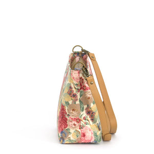 Side view of Pink Floral Crossbody Bag with tan leather strap, by Umpie Bags