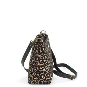 Side view of Leopard Crossbody Bag in fabric with black leather strap