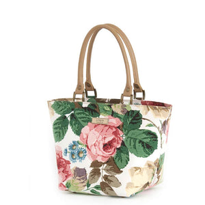 Side view of Floral Handbag Pink with tan leather handles