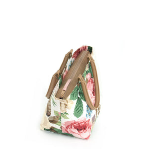 Zip-top view of Floral Handbag Pink Rose Print with tan leather handles