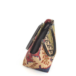 Zip-top view of Kilim Handbag Wine Green with black leather handles