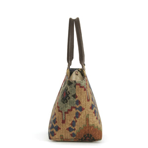 Side view of Kilim Handbag Navy/Wine with brown leather handles by Umpie Bags
