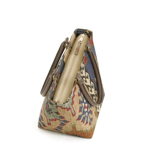 Zip-top view of Kilim Handbag Navy/Wine with brown leather handles