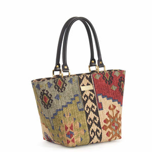 Front view of Kilim Handbag Wine Green with black leather handles
