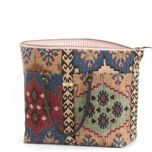 Open view of Kilim Weekend Bag with black leather handles