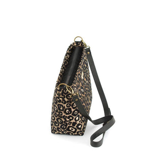 Zip-top view of Leopard Crossbody Bag in fabric with black leather strap