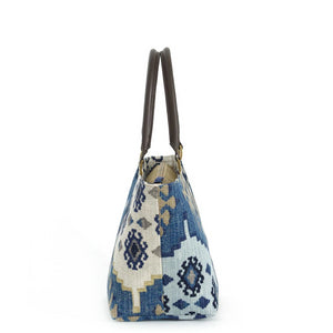 Side view of Navy Kilim Handbag with brown leather handles by Umpie Bags