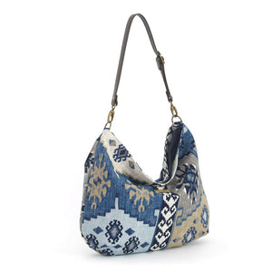 Front view of Navy Kilim Hobo Bag with brown leather strap