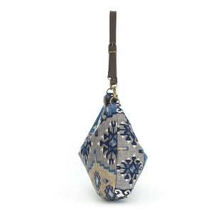 Side view of Navy Kilim Hobo Bag with brown leather strap