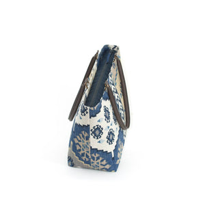 Zip-top view of Navy Kilim Shoulder Bag with brown leather handles