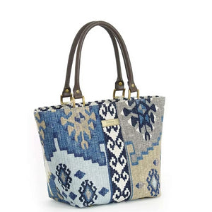 Front view of Navy Kilim Handbag with  brown leather handles by Umpie Bags