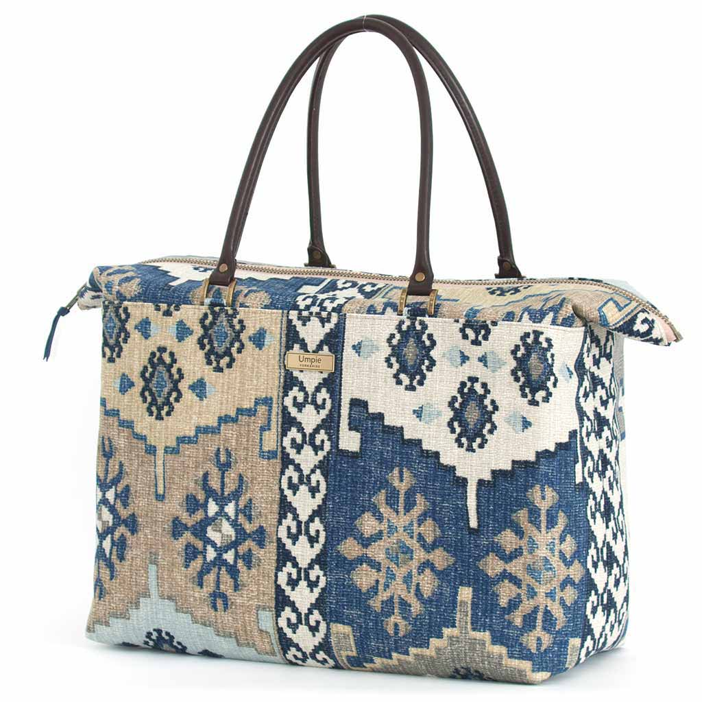 Navy Kilim Weekend Bag with brown leather handles, by Umpie Bags