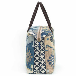 Side view of Navy Kilim Weekend Bag with black leather handles