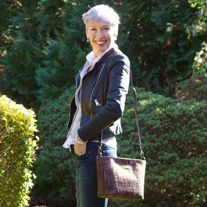 Women wearing the Pink Tweed Crossbody Bag with black leather strap, by Umpie Bags