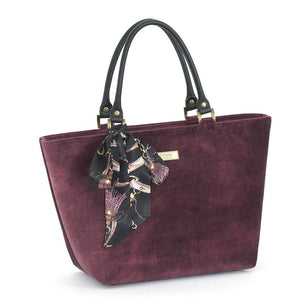 Front view of Aubergine Velvet Grab Bag with black leather handles & Twilly Scarf