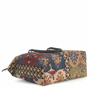 Base view of Kilim Weekend Bag with black leather handles