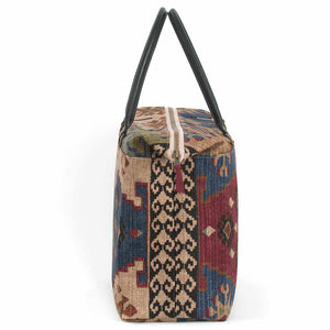 Side view of Kilim Weekend Bag with black leather handles