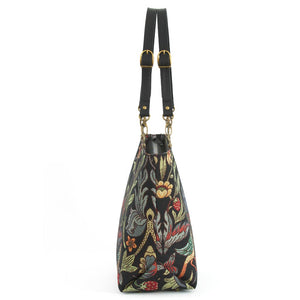 Side view of William Morris Tote Bag with black leather buckled straps