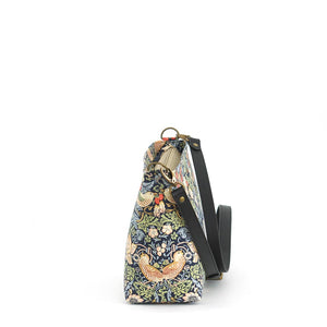 Side view of William Morris Strawberry Thief Crossbody Bag in Navy with black leather strap, by Umpie Bags