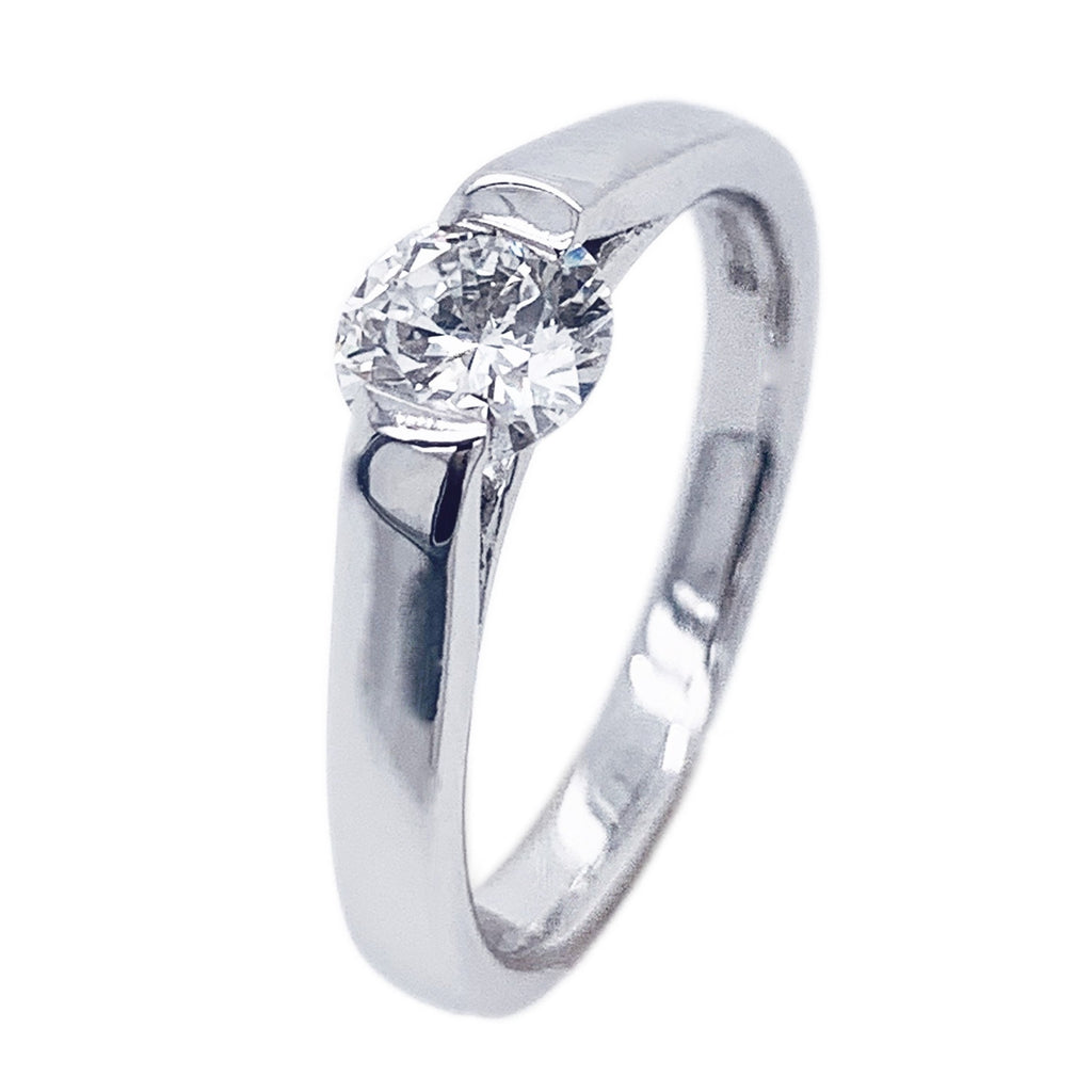 18ct White Gold TRAPEZE Suspension-set Brilliant cut Diamond Ring