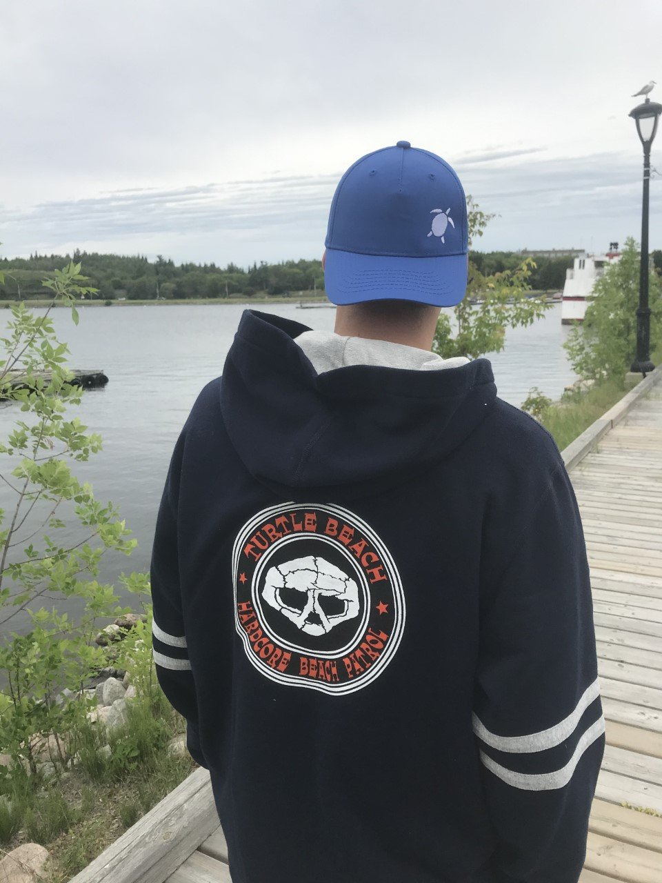 Turtle Beach Clothing hardcore hoodie, Cam Scott looking great rocking the navy sweater on Kenora's harbourfront. Canadian Made, 80% organic cotton.