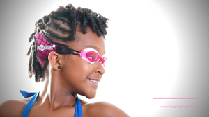 Curly haired girl wearing pink mermaid patterned Frogglez swim goggles