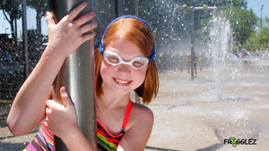 Girl in waterpark wearing Frogglez goggles