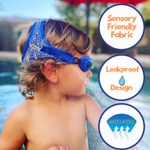 "profile view of young boy with curly hair wearing Frogglez swimming goggles in blue neoprene fabric. He sits on the edge of a swimming pool. text bubbles read, ""sensory friensly fabric,"" ""leakproof design,"" and ""100% UV protection."""