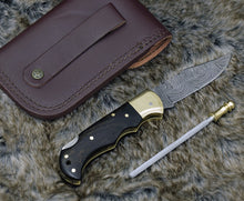 Load image into Gallery viewer, DAMASCUS FOLDING KNIFE, DAMASCUS POCKET KNIFE, CUSTOM DAMASCUS FOLDER, CLIP POINT BLADE, LOCK BACK FOLDING KNIFE, EXOTIC WENGE WOOD SCALES, HAND CARVED SPINE, LANYARD HOLE, HAND STITCHED LEATHER SHEATH - SUSA KNIVES