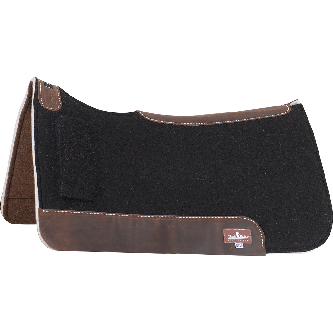 "Thick orthopedic fleece center absorbs shock and disperses pressure. Premium grade felt bottom with shock absorbing wool felt center. Closed-cell foam shim is wedge-shaped to alleviate saddle fit issues. Contoured to fit the horse's shape more closely. Alleviates ""downhill"" saddle fit due to atrophy or conformation issues at the withers. Adjustable correction; slide forward for less, slide back for more."
