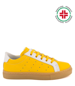 Yellow leather sneakers with amber sole