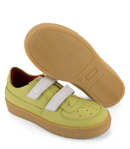 Green leather sneakers with amber sole