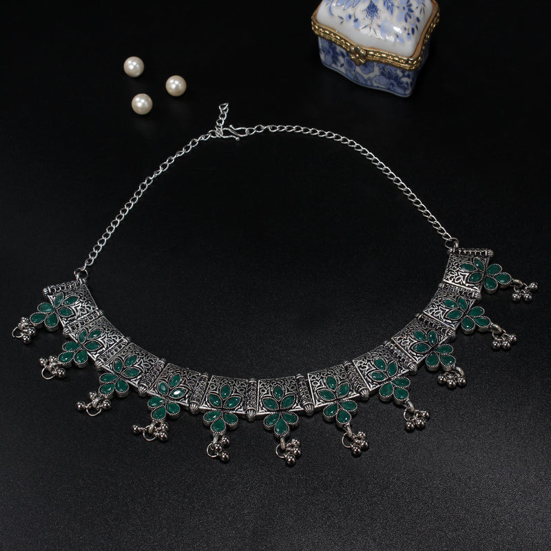 Oxidised necklace embedded with green stones
