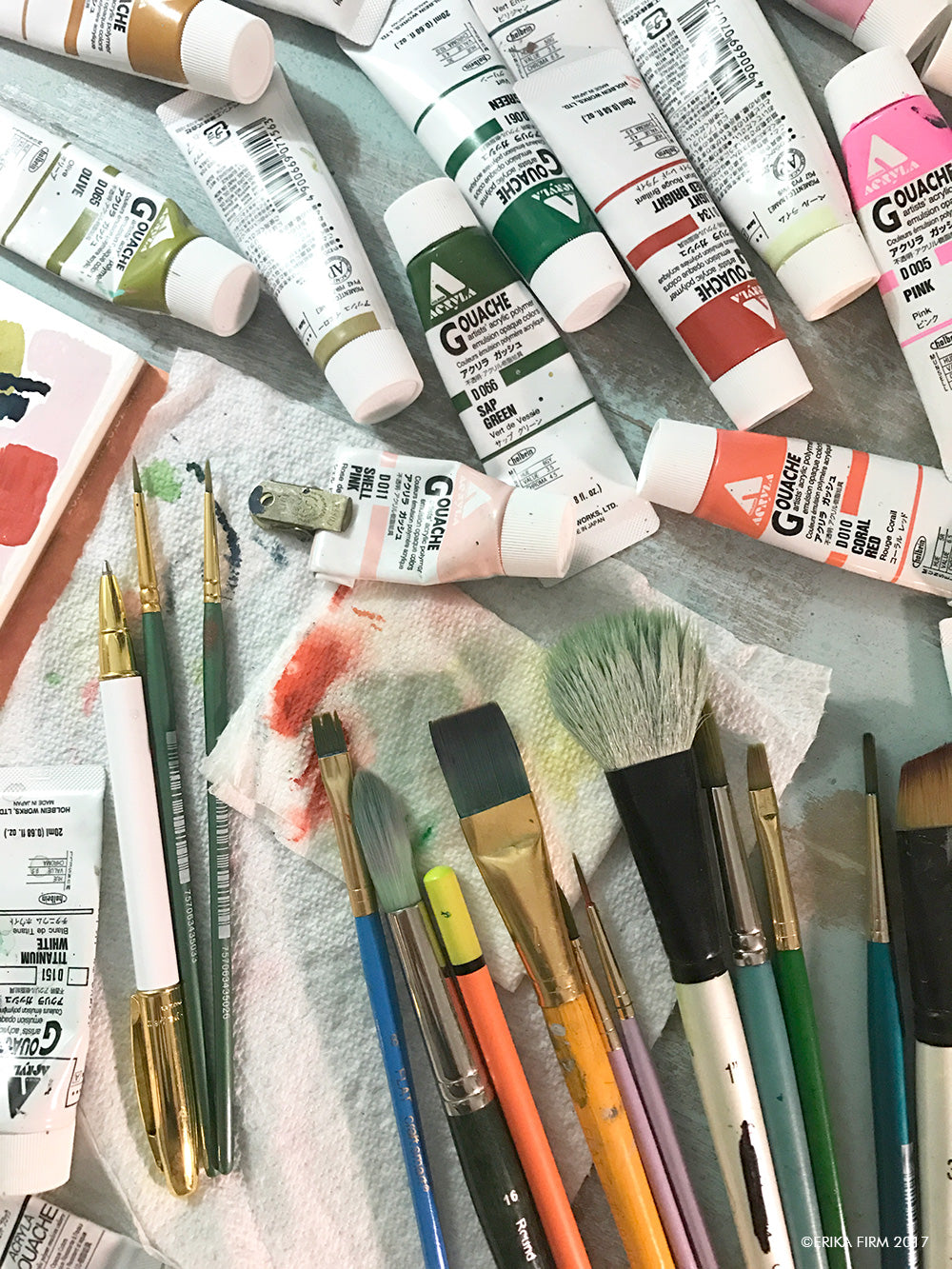 Behind the scenes at Erika Firm studio paint and brushes