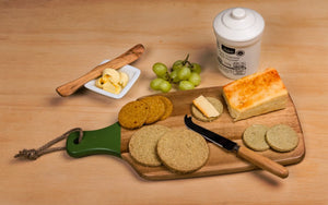 Delicious munchy oatcakes with a subtle hint of chilli.  Perfect teamed with everythingCHILLI relishes and chutneys, paired with your favourite cheese.  Oatcakes on a cheeseboard with butter, cheese and grapes