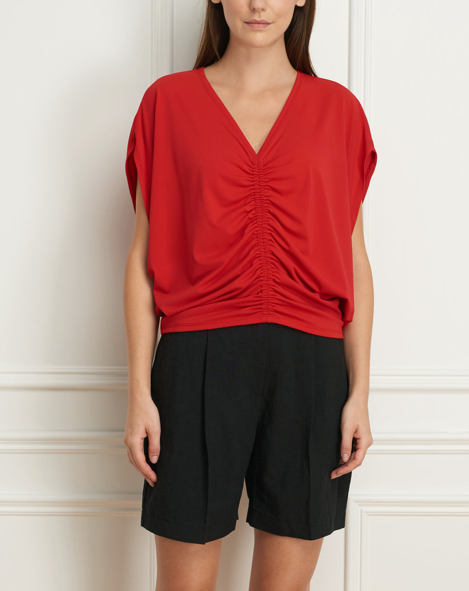 Dolman sleeve top with shirring