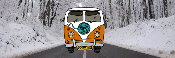 good vibes bus on a snowy road