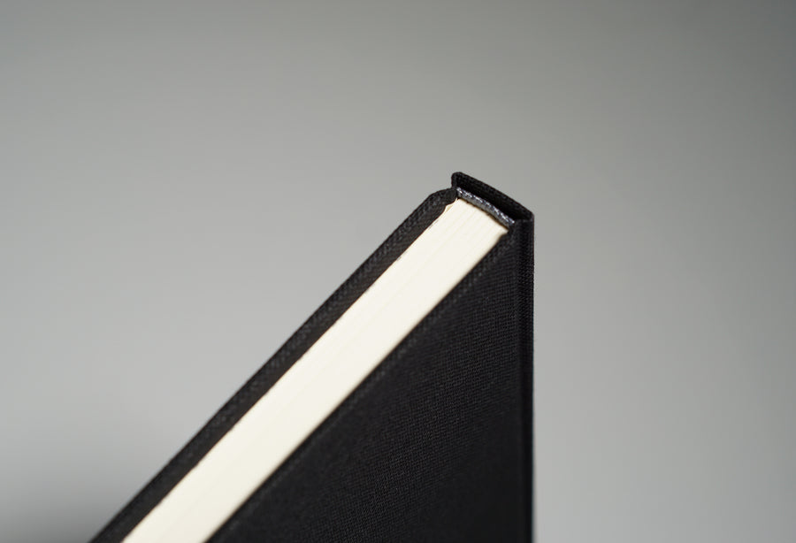 Spine on top of a Black fabric notebook