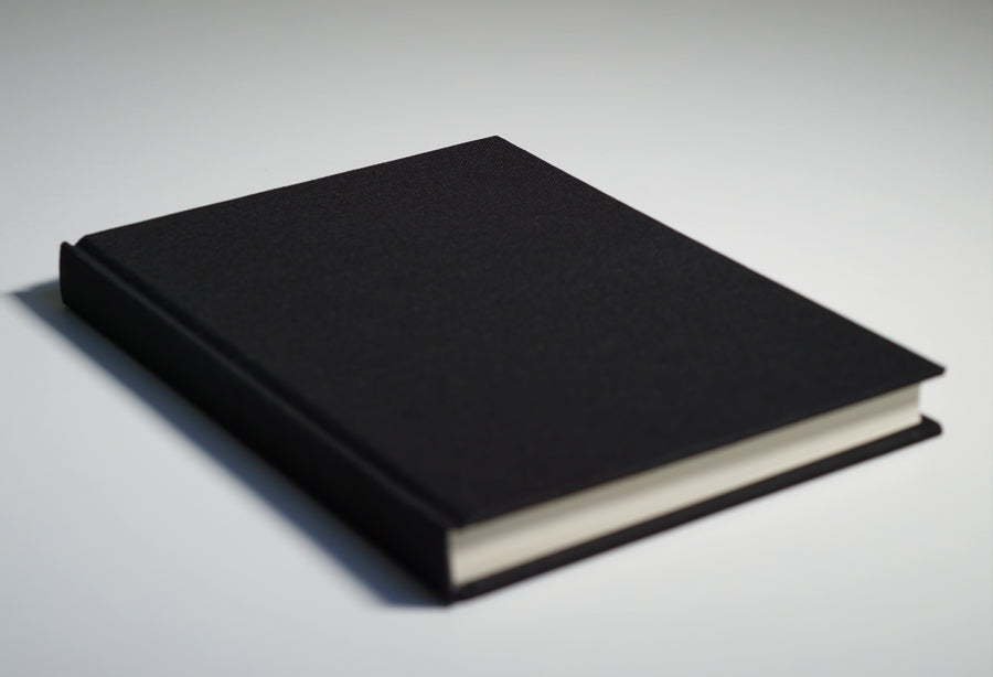 Black fabric notebook lying flat