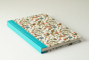 Garden Flowers and Creatures with a Light Blue Spine