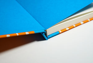 open bright orange notebook