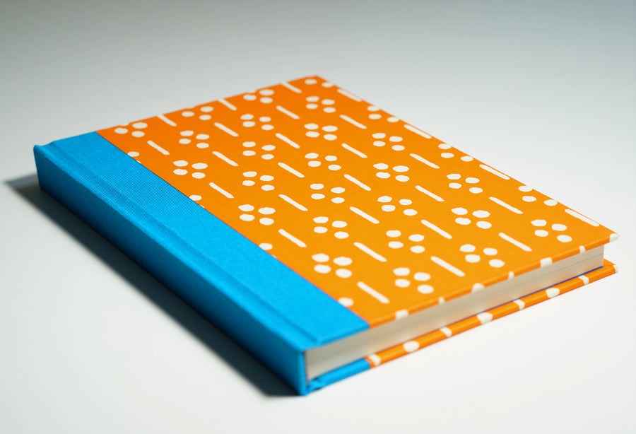 bright orange notebook lying flat