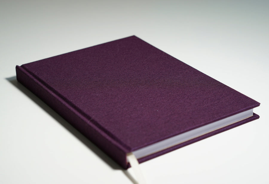 deep purple fabric notebook lying flat