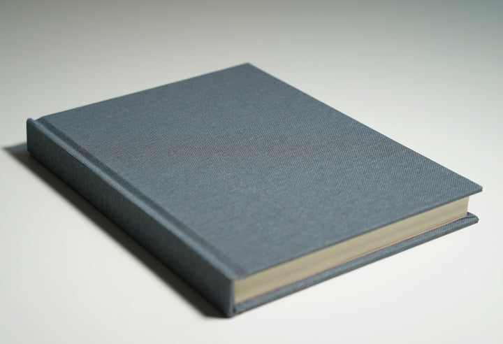 grey linen fabric notebook lying flat