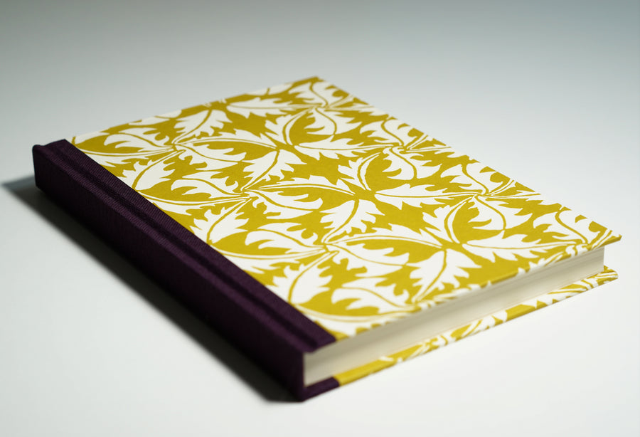 yellow leaf patterned notebook lying flat