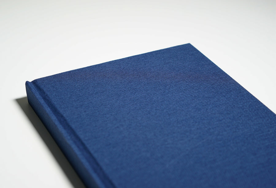 top half of navy linen fabric notebook