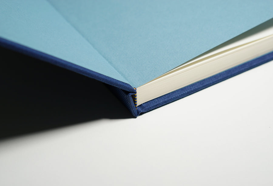open navy linen fabric notebook spine