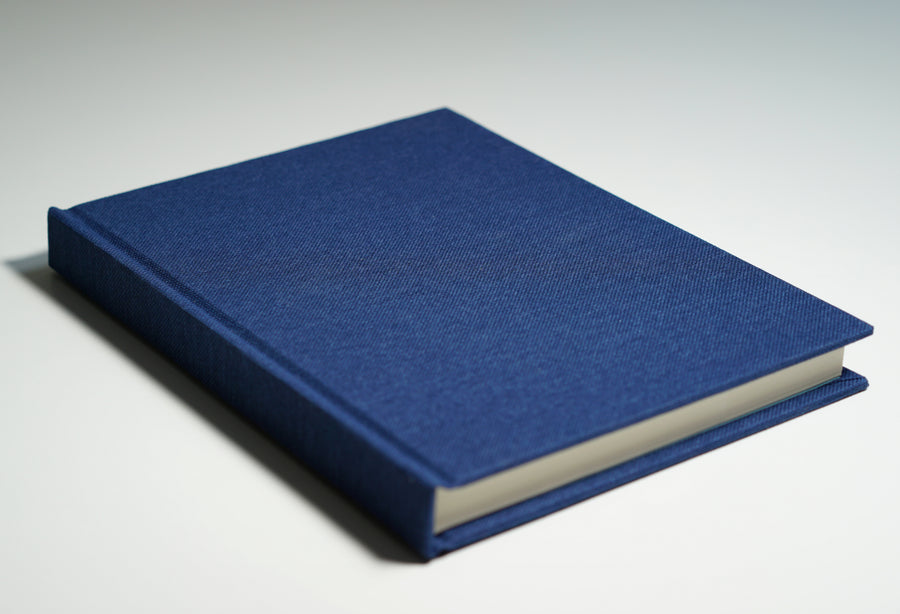 Navy linen fabric notebook lying flat