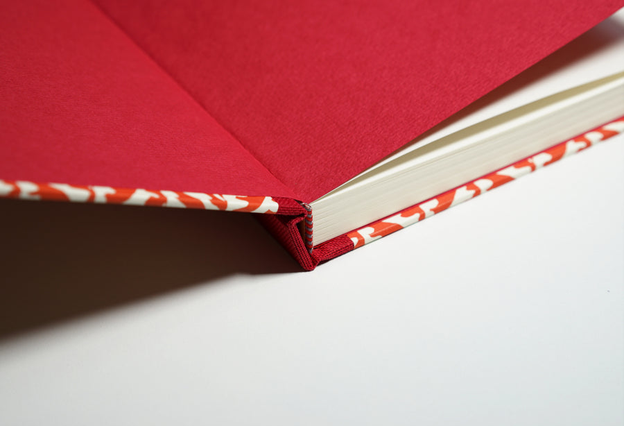 open red tile patterned notebook
