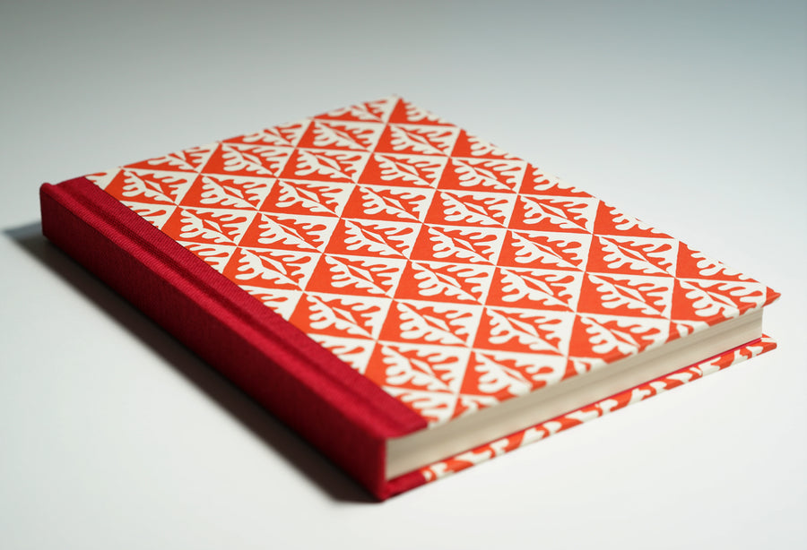 red tile patterned notebook lying flat